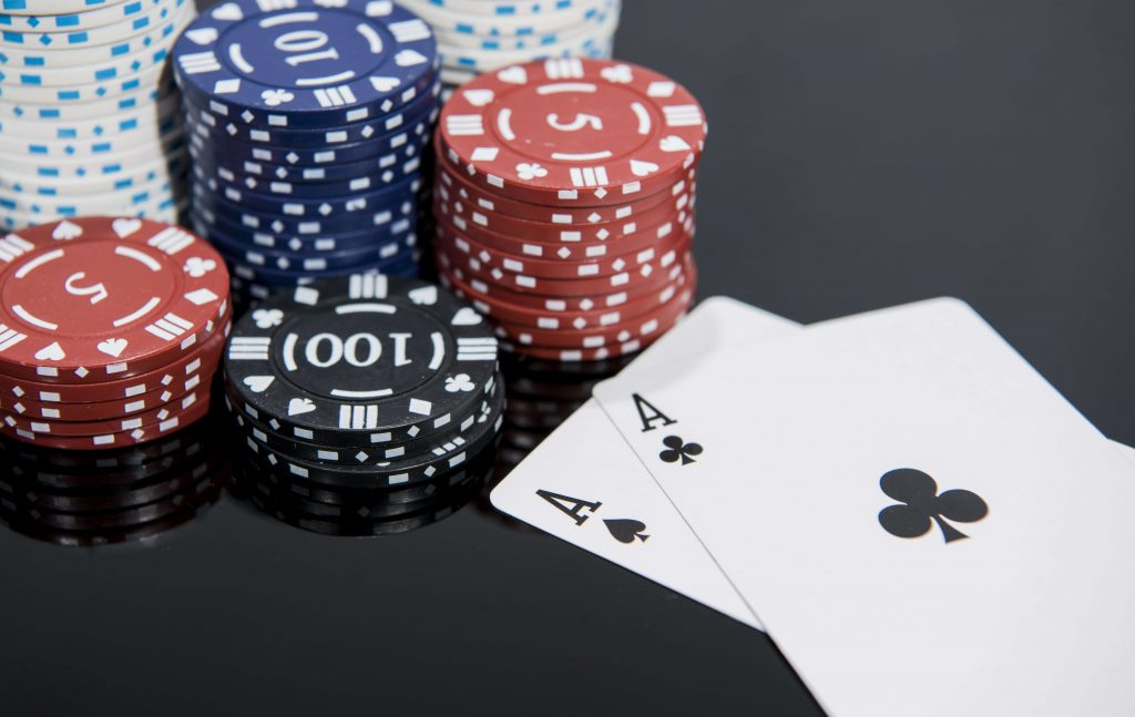 chips_aces_on_black_background