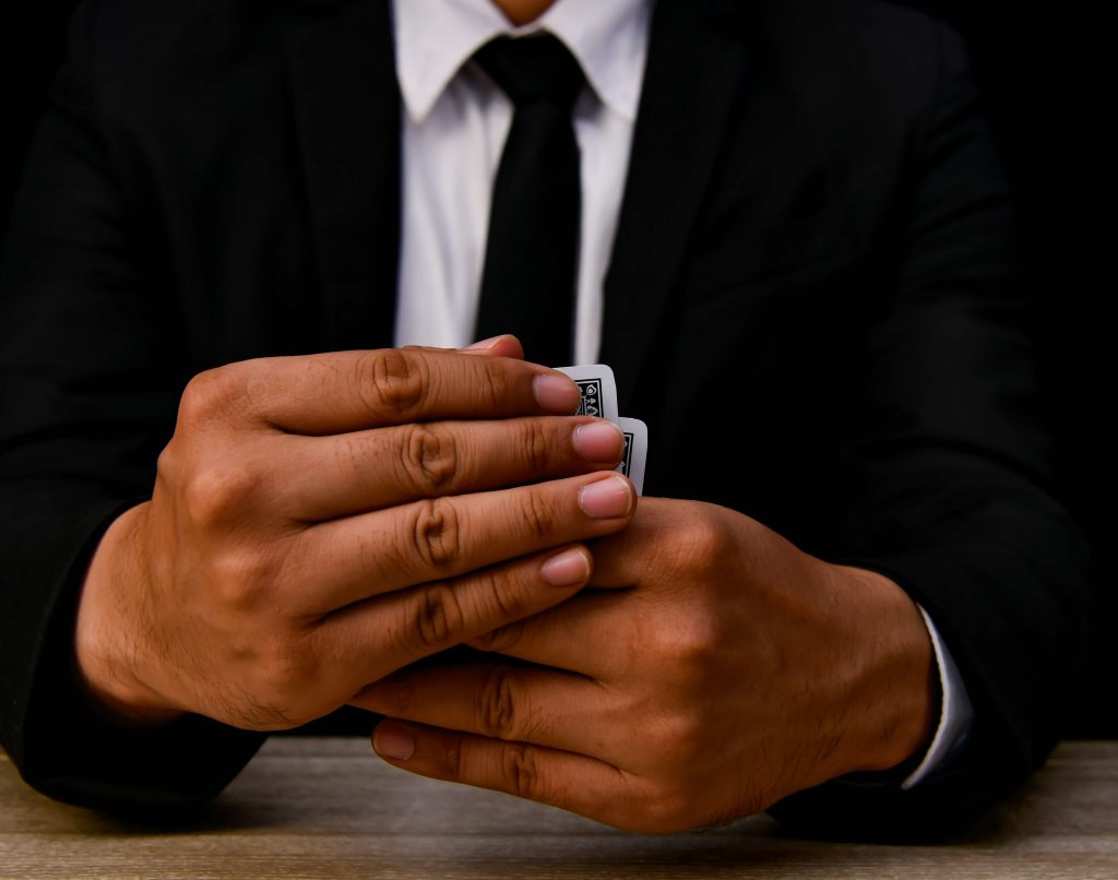 man_in_suit_with_cards